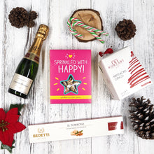 Our Classic Christmas Hamper contains good old traditional Christmas goodies such as panettone, nougurt, chocolate biscuits and champagne that's been given a modern twist with their packaging.