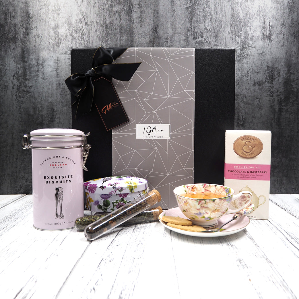 Tea, cookies, fudge and teacup set hamper. Free hamper delivery within Singapore.