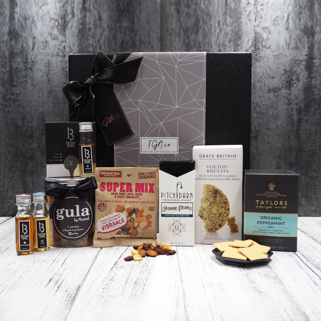 Tea, honey, biscuits and chocolate gift hamper. Free hamper delivery within Singapore.