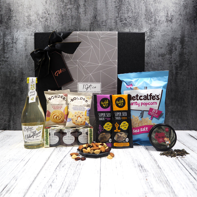Tea, biscuits, jams, nuts, popcorn foodie gift hamper. Free delivery within Singapore