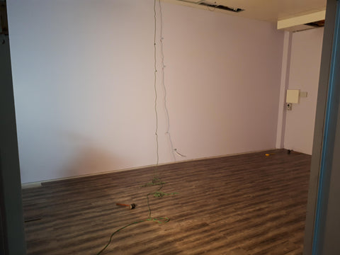Picture of the new classroom floor and walls freshly painted and laid.