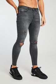 GREY RIPPED AND REPAIRED JEANS