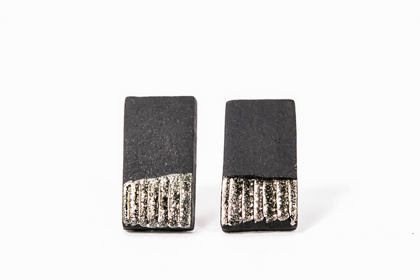 Black ceramic earrings with platinum luster on white background from porcelain jewelry collection