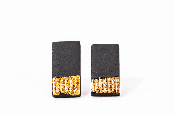 Black ceramic earrings with gold luster on white background from porcelain jewelry collection