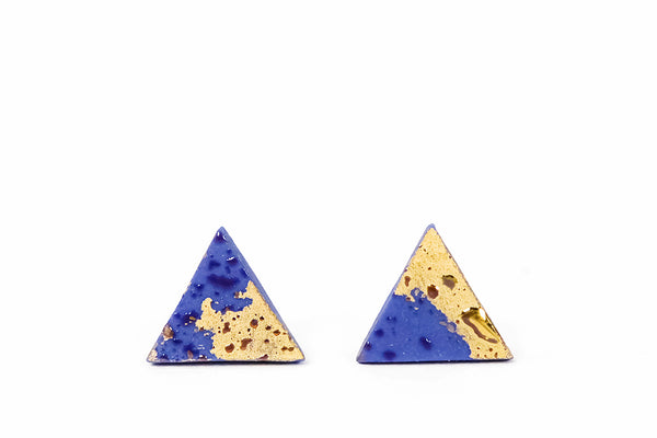 cobalt blue ceramic earrings with gold luster on white background