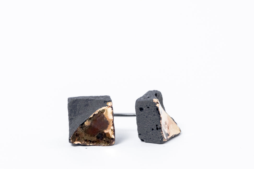 Minimal studs made from black porcelain