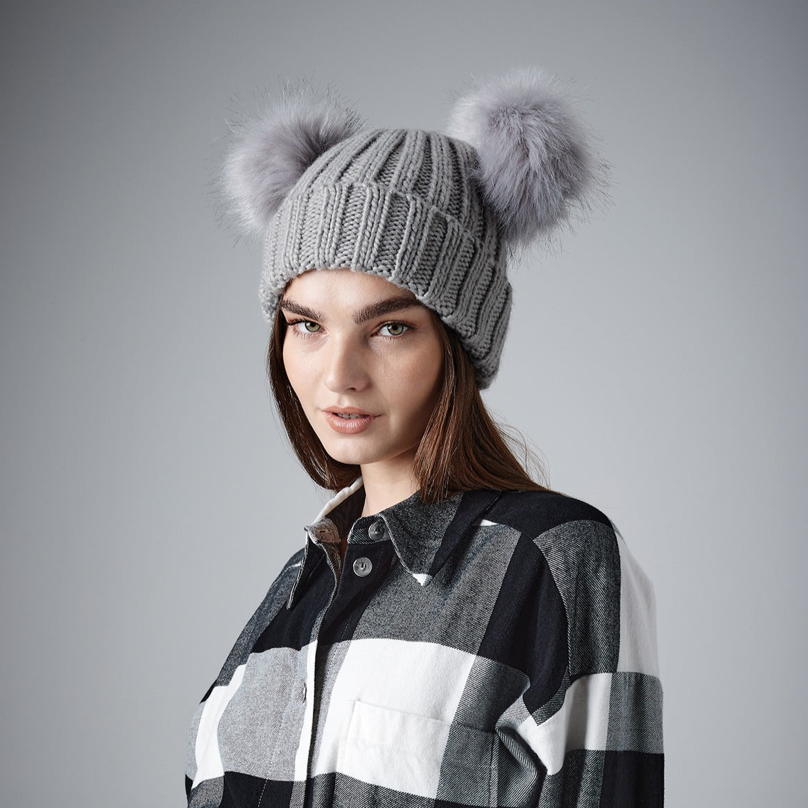 faux fur double pom beanie by Whistling Dixie