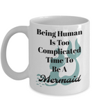 Being human is to complicated time to be a mermaid