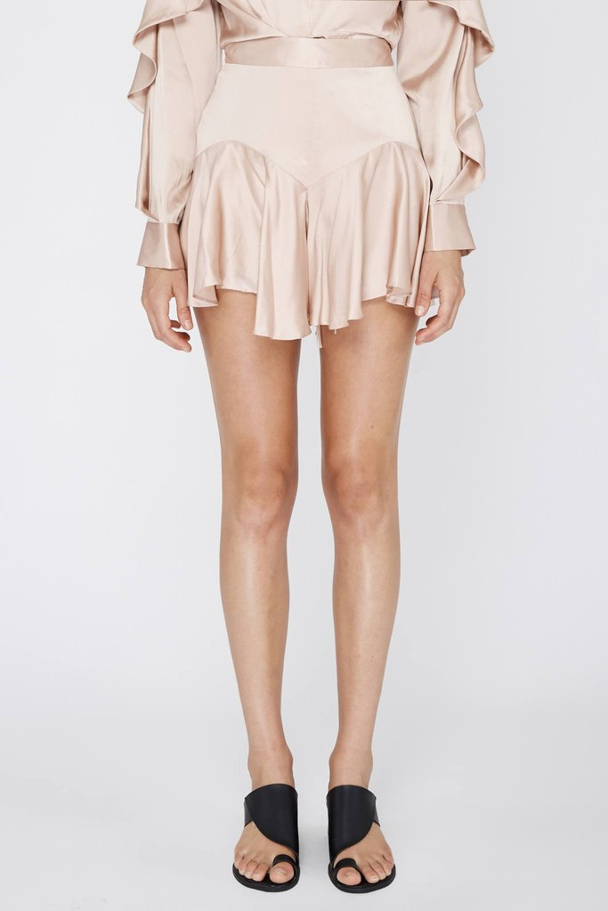 The Florence Silk Shorts from Acler features a fitted high waist with a flowing flare at the bottom.