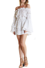 Marie Ange Dress is a white off the shoulder mini dress with long bell sleeves and ties at waist