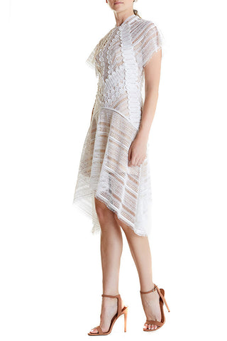 White lace dress from Acler, asymmetric hem, high neckline and short sleeves