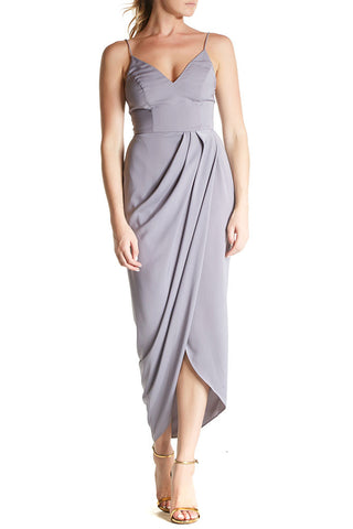 This dress features spaghetti straps, v-neck, and a cross over draped skirt with front split.Grey