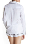 Sydney Blouse from Maison Du Soir, a white pajama shirt with black piping