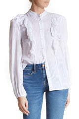 Alice McCall Empire shirt features a design with eyelet ruffles at the shoulders and long sleeves.