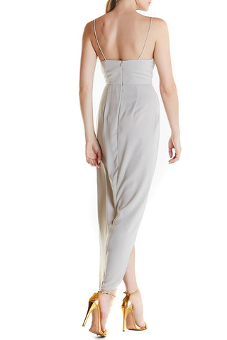 This dress features spaghetti straps, v-neck, and a draped skirt with front split. Light grey