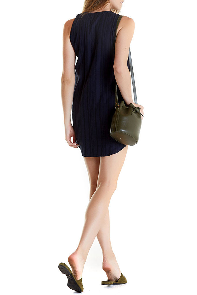 The Cassie Shirt Dress from SIR is a sleeveless button down dress with a relaxed fit.