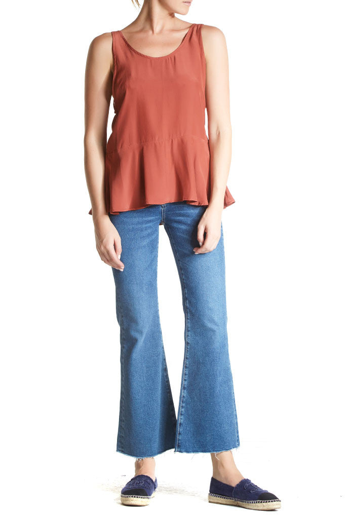 The Elke Tank by SIR is a relaxed silk tank with low arm hole and peplum detail at the waist. Rust