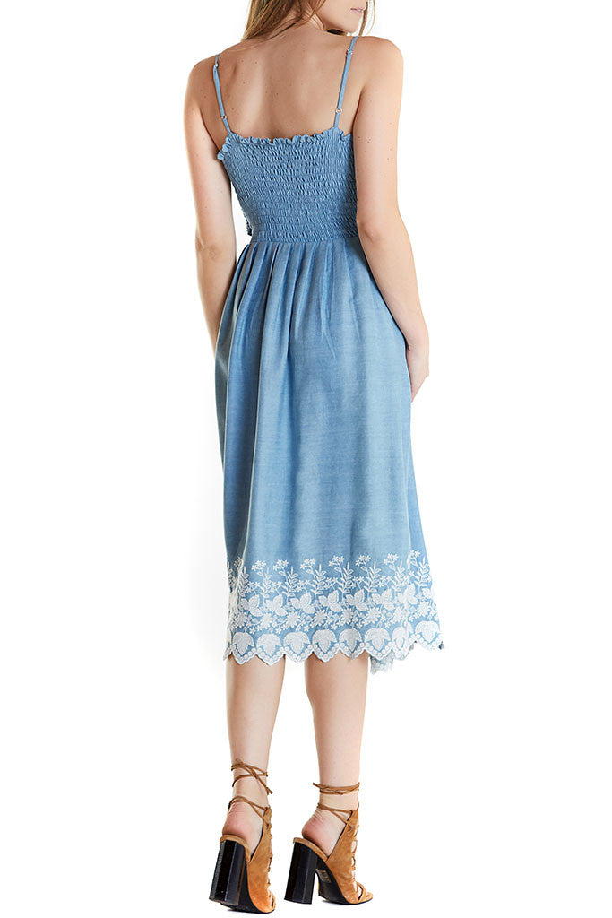 Jenna Dress from Love Shack Fancy, blue indigo midi dress, fitted over chest and loose from waist