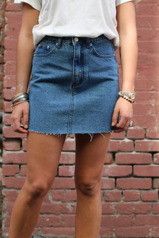 The Indigo Denim Skirt from Zulu & Zephyr is an a-lined fit denim skirt with raw hem