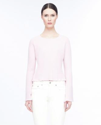 The Martine, a pink cashmere sweater by LINE features long bell sleeves and a scoop neck.