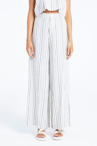 The Brenda Striped Wide Leg Pants from Zulu & Zephyr is made out of a textured linen fabric