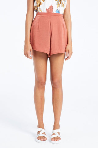 The Wendy Shorts from Zulu & Zephyr are a high waisted silky coral shorts with a flat waistband