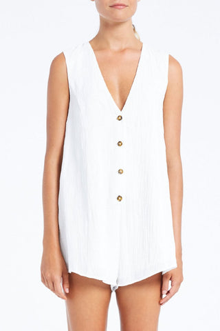 The Kim Playsuit from Zulu & Zephyr in white cotton and with a v-neck and buttons down the front.