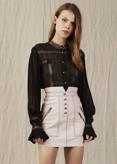 The Aje Emmeline Blouse is a detailed georgette blouse featuring pintuck pleating and lace panelling
