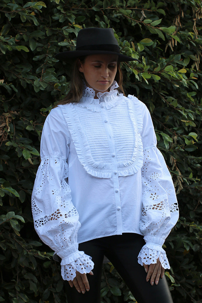 The Isabelli Blouse from Aje features ruffle detail trim, embroidered eyelet sleeves and collar