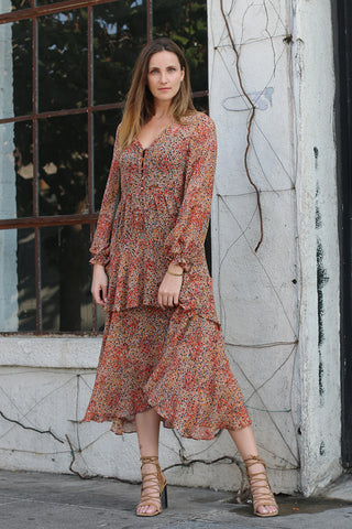 Alexandra Dress from LSF, a low neckline with buttons, long loose sleeves and a layered midi-length