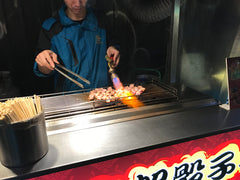 Taipei street food grilling meat blow torch