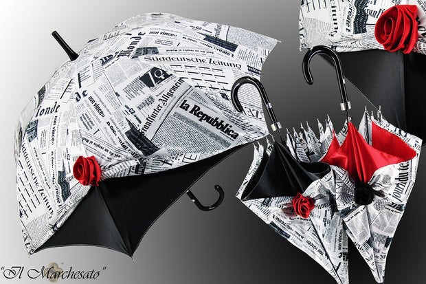 newspaper umbrella with red or black roses