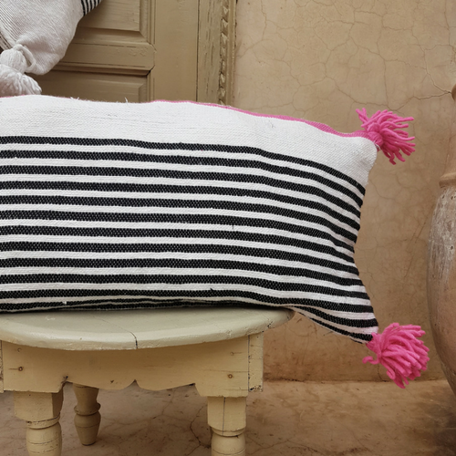 pompom blanket pillow with pink pompoms