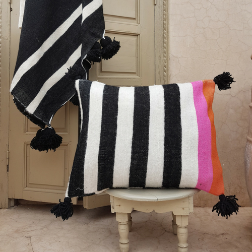 pompom blanket pillow with black pompoms
