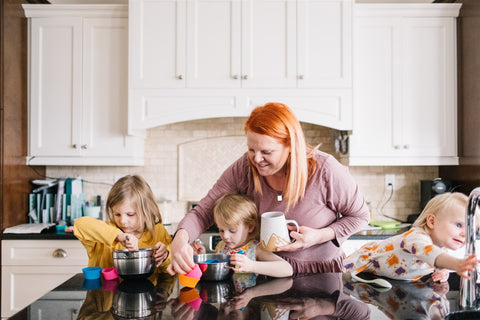 mom and kids making cookies or muffins