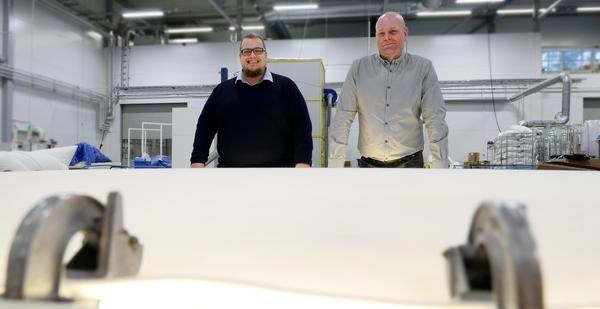 IT & LOGISTICS MANAGER SAMI SALONEN AND VICE PRESIDENT ERKKI JUHONEN WITH A DOWN DUVET AT THE COMPANY'S SEWING DEPARTMENT.