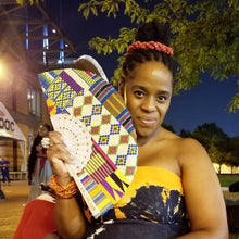 Thembisa Mshaka with Rainbow Kente Chuuuch Fan by Kannu Collection