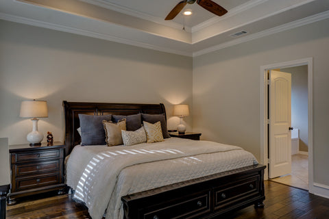 Bedroom with large bed and nightstand