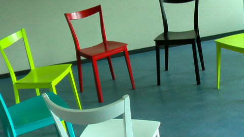 Colored chairs arranged in a circle for a therapy session.