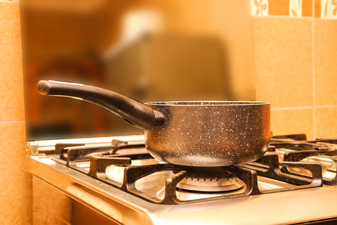 Pot sitting on stove in a kitchen