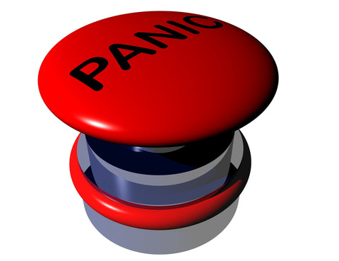"Red button with the word ""panic"" written on it"