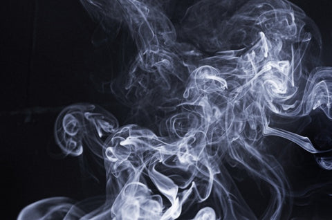 Smoke rising with a black background