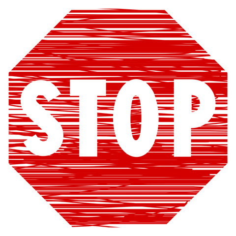 "Red sign with the word ""stop"" on it."