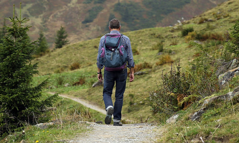 Man hiking to combat COPD-related anxiety, fatigue, and chronic pain