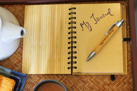 """Journal lying on a table with the words """"my journal"""" written on it."""