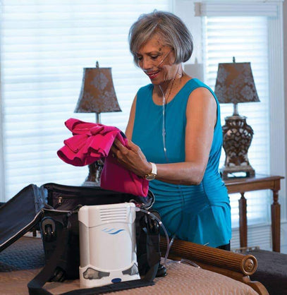 Woman packing bags with the Caire Freestyle Comfort