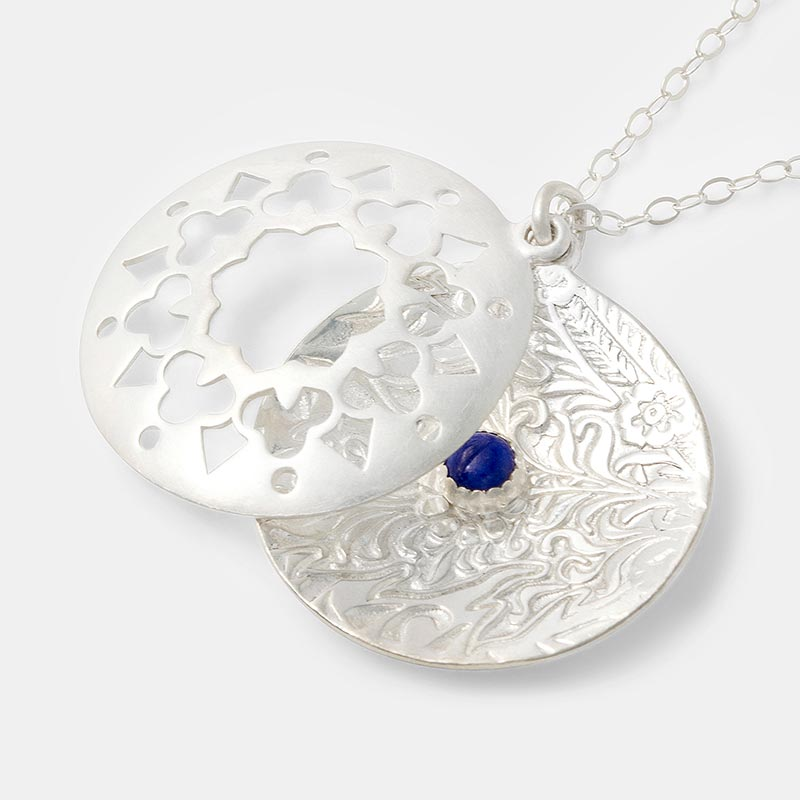 Mandala pendant in sterling silver and a lapis lazuli gemstone.