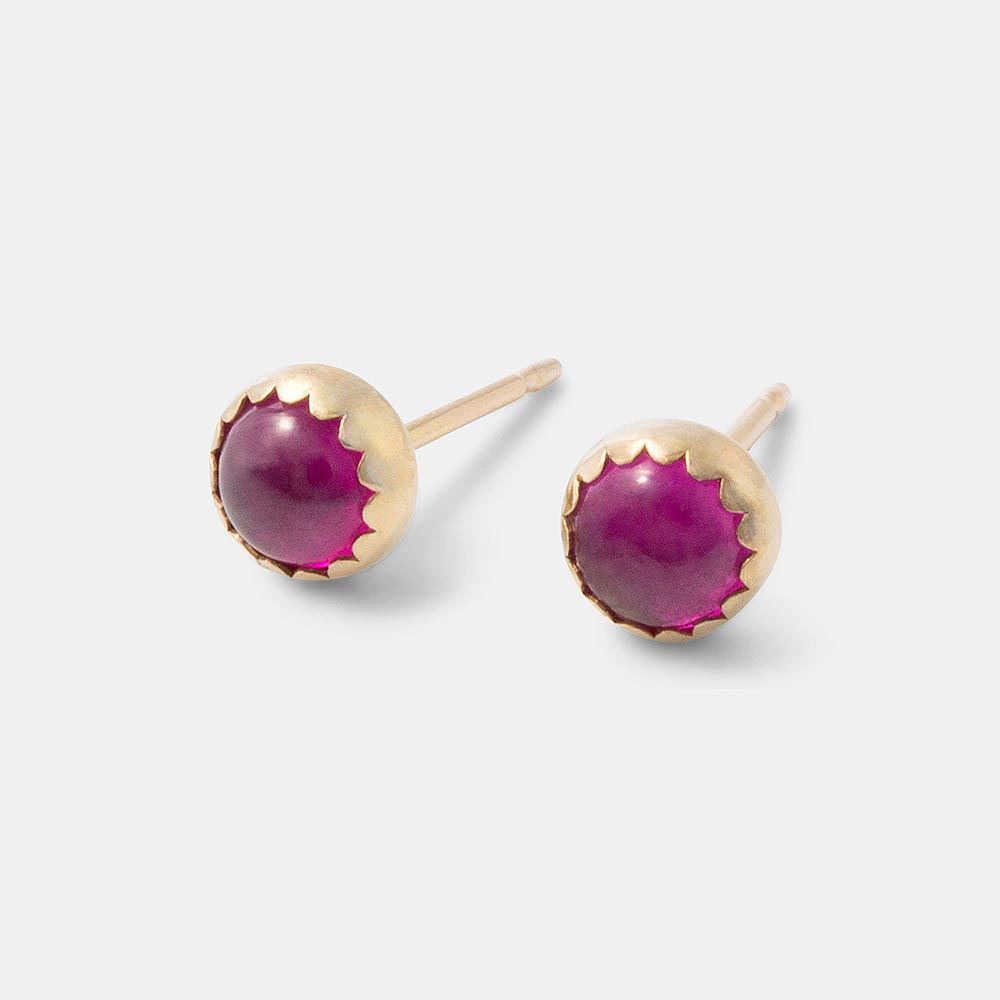 Handmade solid gold stud earrings with bright pink rubies.
