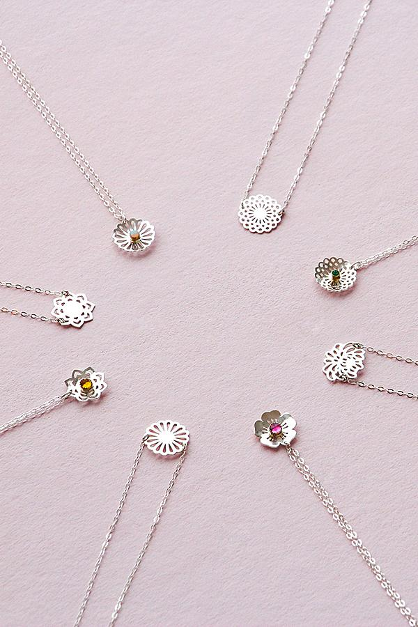 Bouquet jewelry: unique handmade jewelry in sterling silver, gold and gemstones. Check out the daisy and opal pendant necklace.