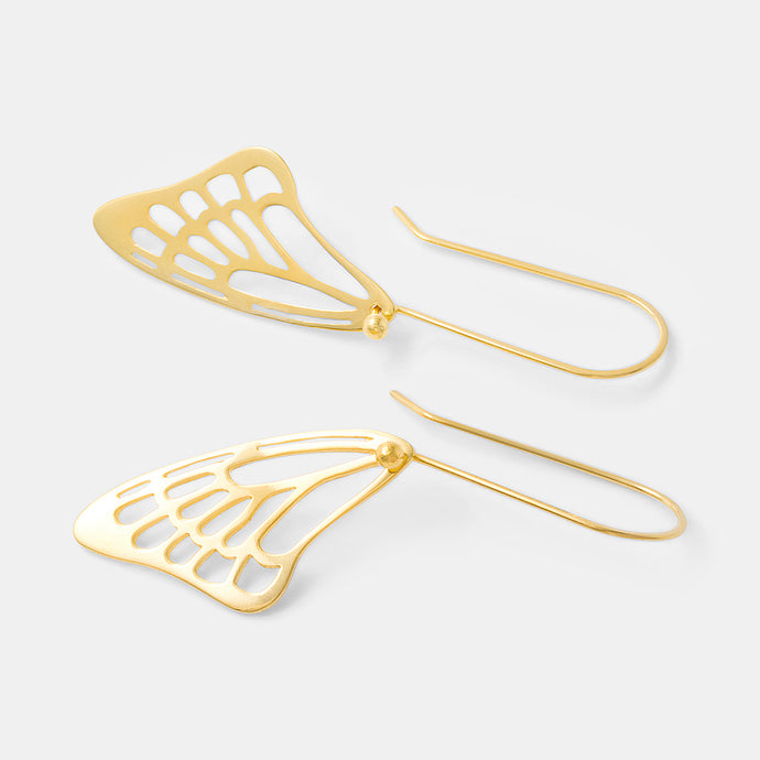 Butterfly wing dangle earrings in gold by handmade jewelry designer Simone Walsh.